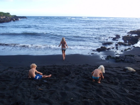 Washing off the black sand