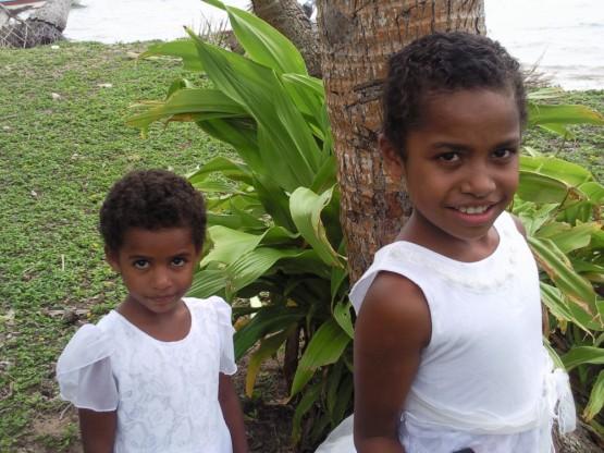 Tulala's kids on the way to church