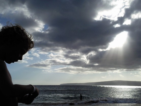 late breakthrough of the sun at Wailea's Big Beach on the Southwest coast