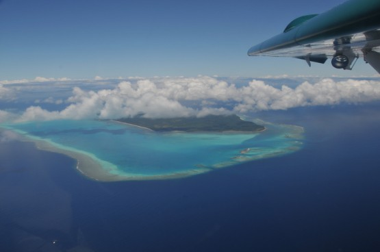 typical Fiji view, reef with waves, atoll, island with picture perfect beaches