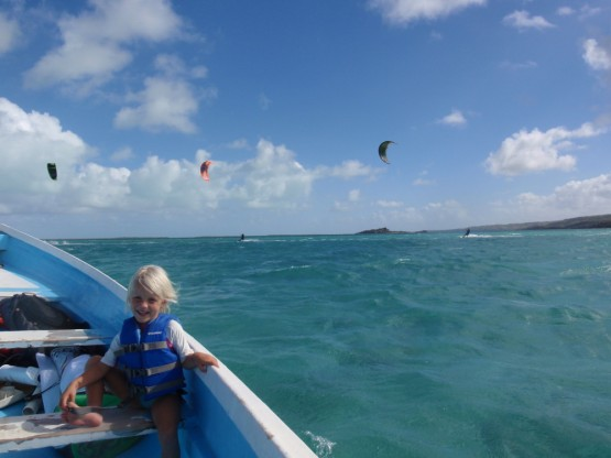 kids on boat, parents in lagoon