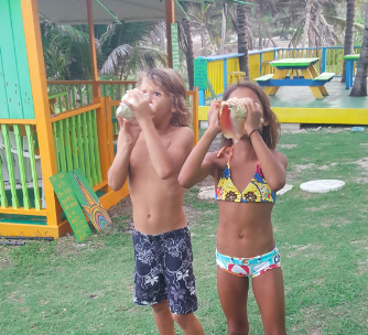 Brian's kids showing off their concha shell blowing skills